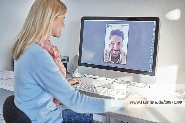 Woman making desktop video call to boyfriend