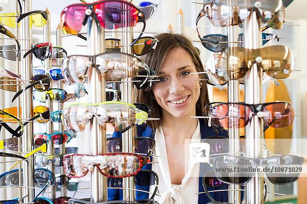 View through eyeglasses display of woman looking at camera smiling