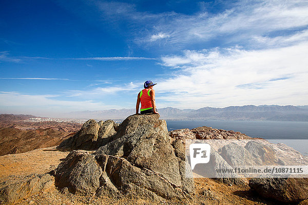 Female hiker enjoying the view from a summit of the Eilat mountains  Israel