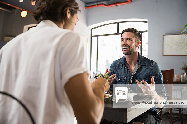 Man in restaurant chatting with friend