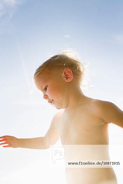 Baby girl  outdoors in sunlight