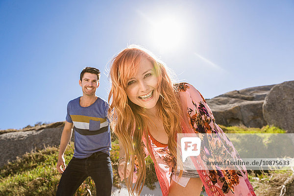 Couple outdoors  holding hands  laughing