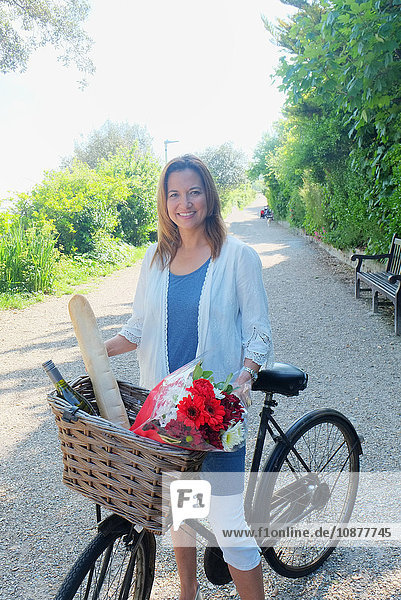 Woman on bicycle looking at camera smiling