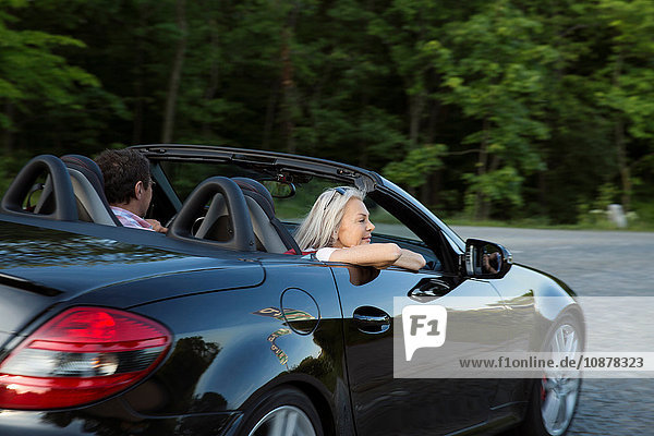 Mature couple in convertible car