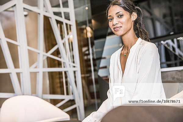 Businesswoman looking at camera smiling