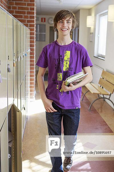 Sweden  Teenage boy (14-15) walking on school corridor