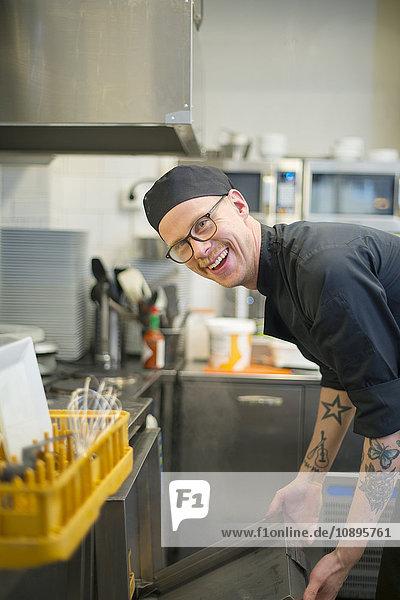 Sweden  Man in cafe kitchen