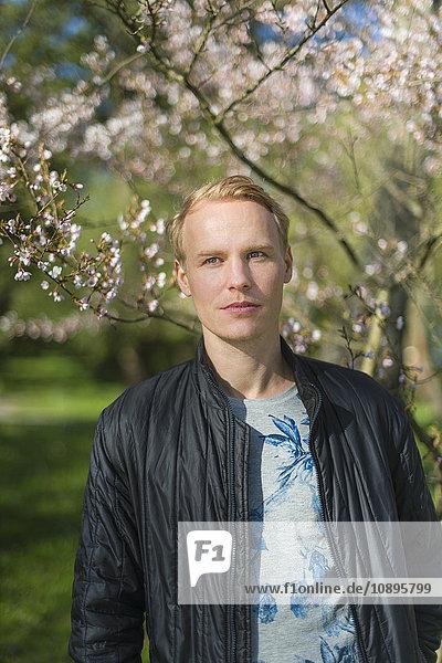 Sweden  Uppland  Stockholm  Portrait of man in park