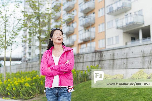 Sweden  Uppland  Stockholm  Kungsholmen  Hornsbergstrand  Woman standing in park
