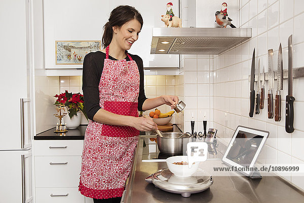 Sweden  Woman cooking in kitchen