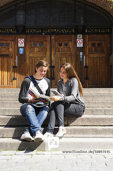 Sweden  Stockholm  Ostermalm  Students sitting on stairs in front of school building