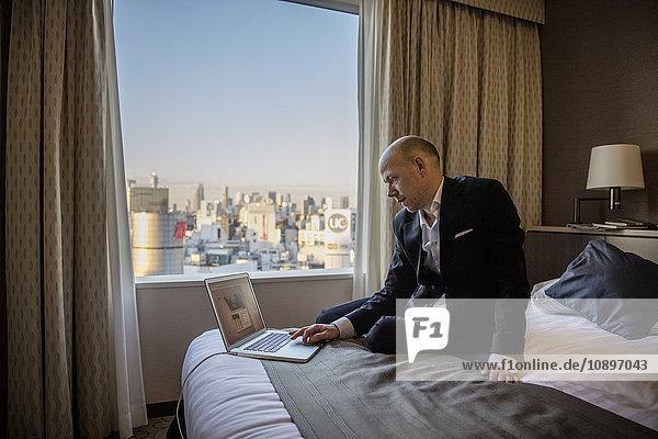 Japan  Tokyo  Shibuya  Businessman working in hotel room