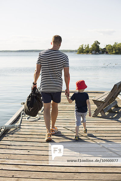 Sweden  Stockholm Archipelago  Grasko  Father and son (6-7) on jetty