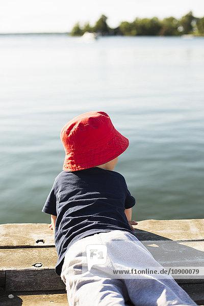 Sweden  Stockholm Archipelago  Grasko  Boy (6-7) lying on jetty