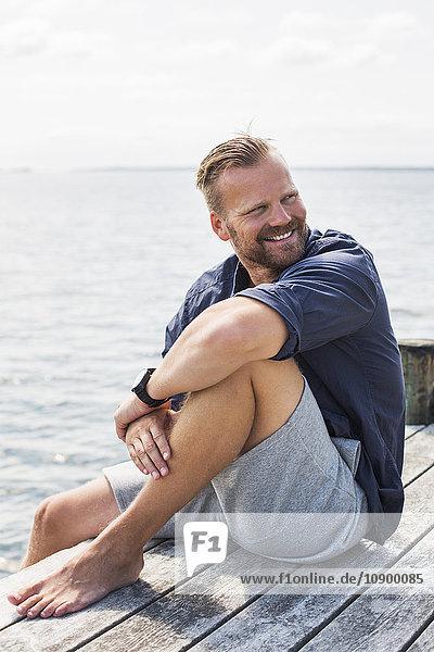Sweden  Stockholm Archipelago  Grasko  Portrait of man on jetty