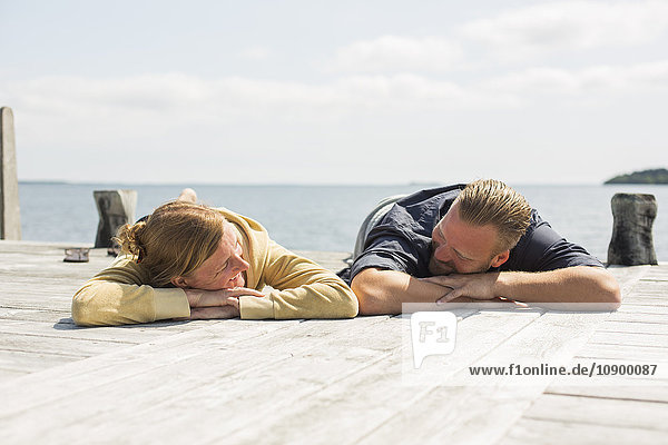 Sweden  Stockholm Archipelago  Grasko  Mature couple relaxing on jetty