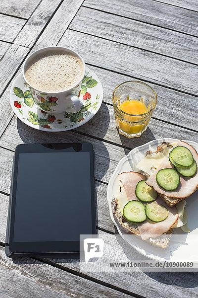 Sweden  Stockholm Archipelago  Grasko  Elevated view of breakfast and digital tablet