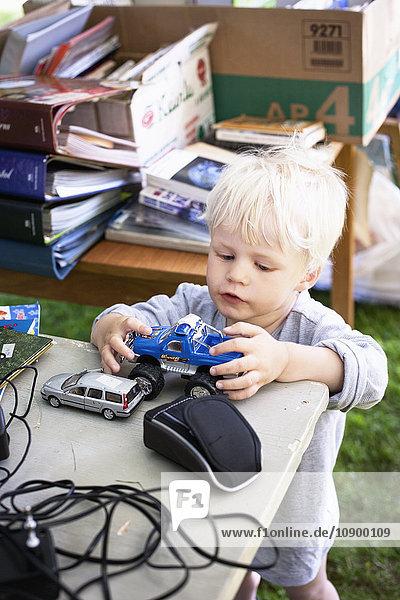 Sweden  Gotland  Ljugarn  Boy (2-3) playing with toys