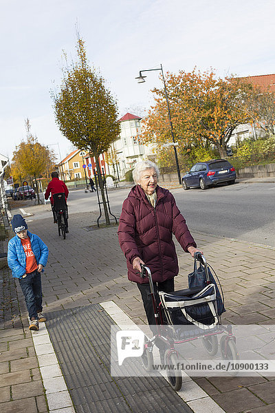 Sweden  Smaland  Tingsryd  Boy (6-7) walking with great-grandmother