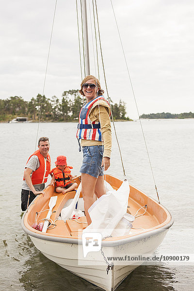 Sweden  Sodermanland  Stockholm archipelago  Musko  Family with child (4-5) wearing life jackets on sailboat on river