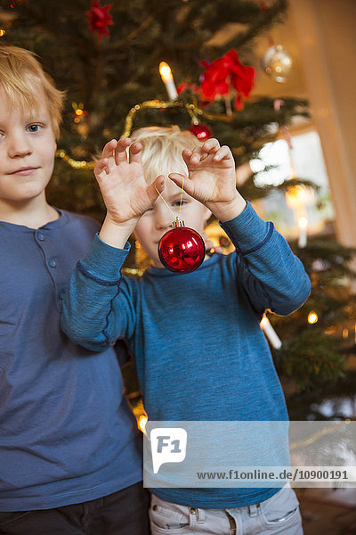 Sweden  Two brothers (4-5  6-7) with Christmas decoration toys