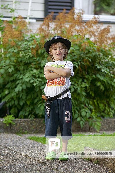 Sweden  Vastergotland  Lerum  Portrait of boy (8-9) in cowboy costume