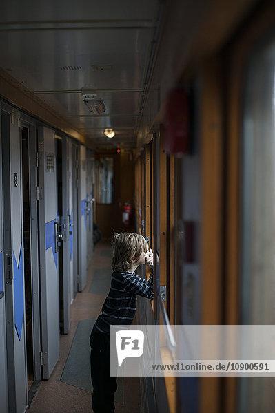 Sweden  Jamtland  Are  Boy (8-9) looking through train window