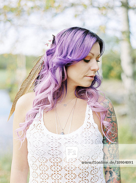 Sweden  Bride with long purple hair and tattoo at hippie wedding