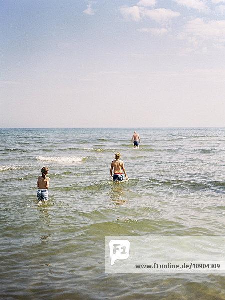 Sweden  Gotland  Two boys (8-9  10-11) standing in sea water