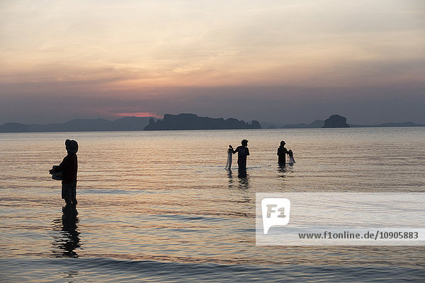 Thailand  Krabi  tubkaek  fishing men at sunset