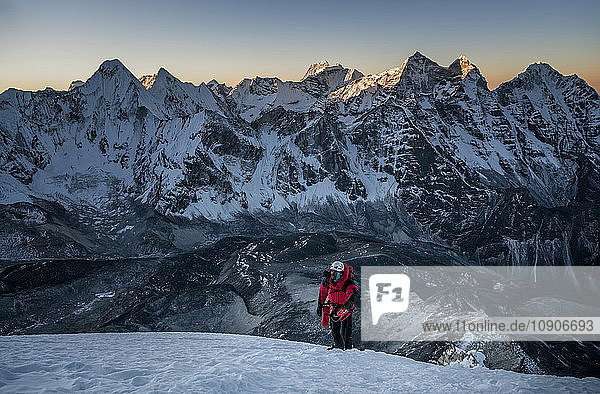 Nepal  Himalaya  Solo Khumbu  mountaineer at Ama Dablam South West Ridge at twilight