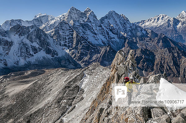 Nepal  Himalaya  Solo Khumbu  Ama Dablam South West Ridge  mountaineer climbing up rocks
