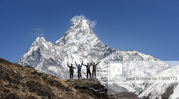 Nepal  Himalaya  Solo Khumbu  Ama Dablam  four Gurkhas in mountainscape cheering