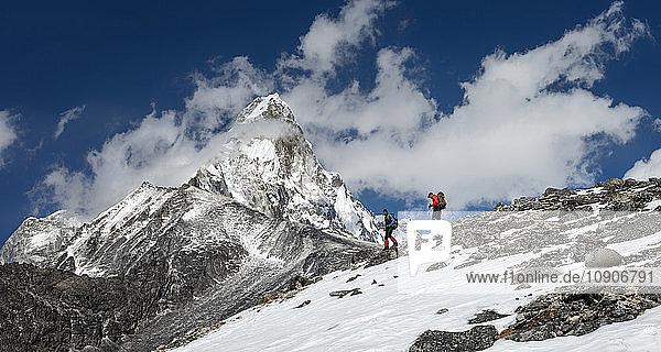 Nepal  Himalaya  Solo Khumbu  Ama Dablam  two men trekking