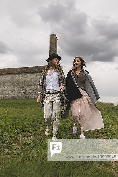 Two female friends walking in nature