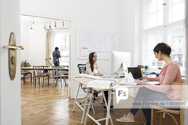 Creative professionals working in office