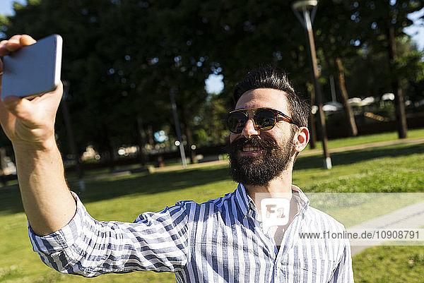 Smiling man taking selfie