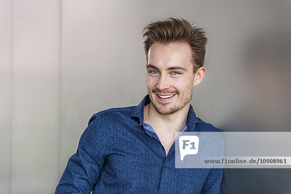 Portrait of smiling young businessman with stubble