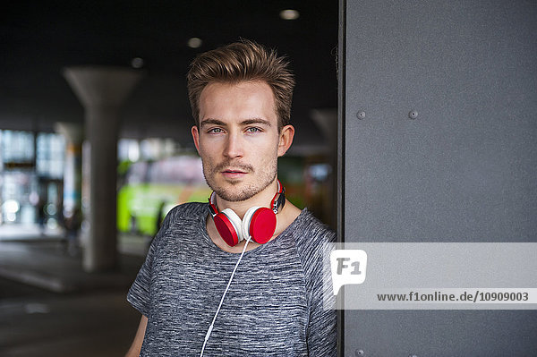 Portrait of young man with red headphones