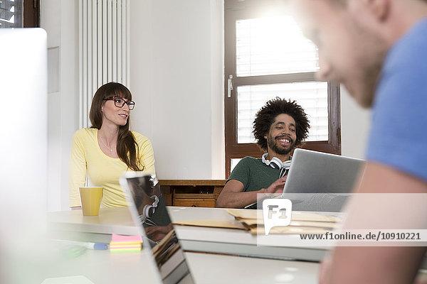Drei Kreativprofis im Büro