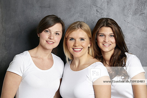 Group picture of three smiling friends
