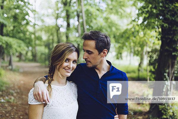 Portrait of couple in love walking in the woods