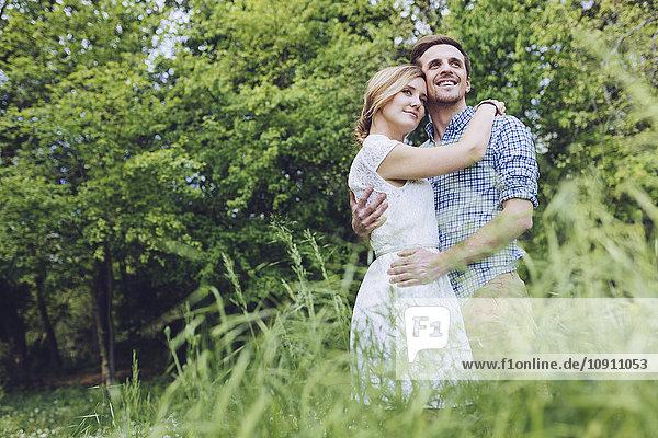 Portrait of happy couple in nature