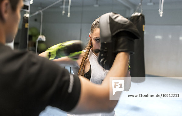 Young woman in gym doing boxing training