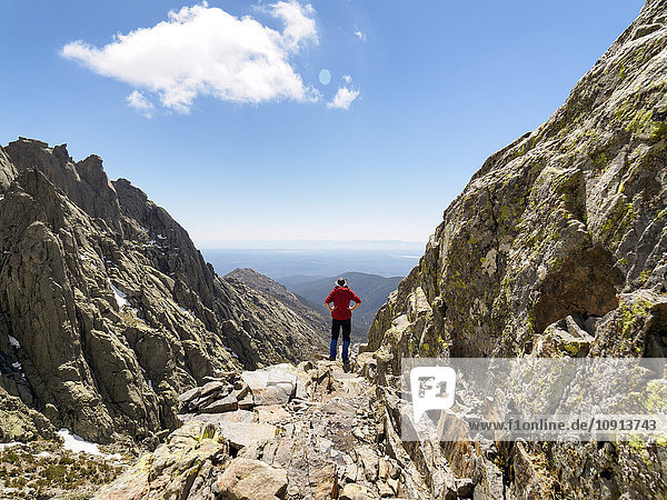 Spain  Sierra de Gredos  hiker standing on rock in mountainscape