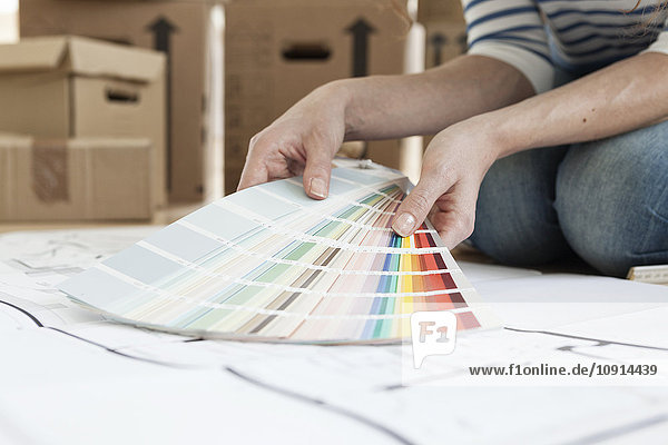 Woman with color samples on floor