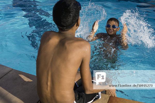 Two boys in swimming pool