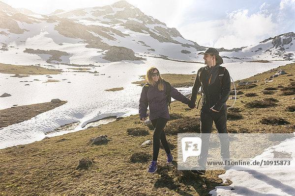 Spain  Asturias  Somiedo  couple hiking in mountains