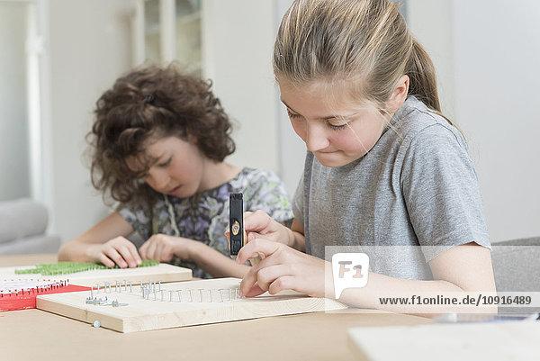 Two girls making nail images