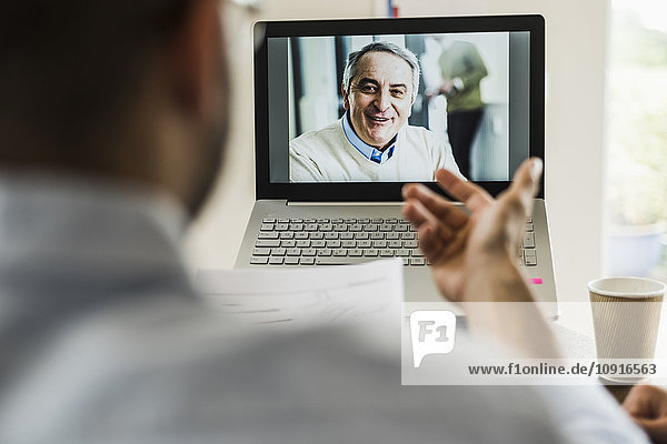 Businessman having a video conference in office